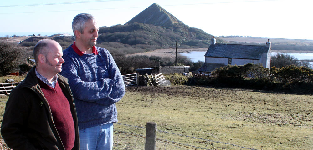 """Cllr Dick Cole with Cllr Matthew Luke (Penwithick and Boscoppa) at """"West Carclaze"""" where green fields could be lost to the proposed """"eco-community."""""""